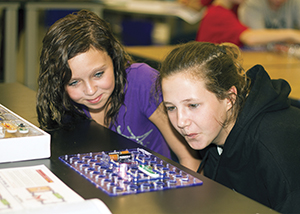 Maker STEM camp participants build and test electronic circuits to run small engines.