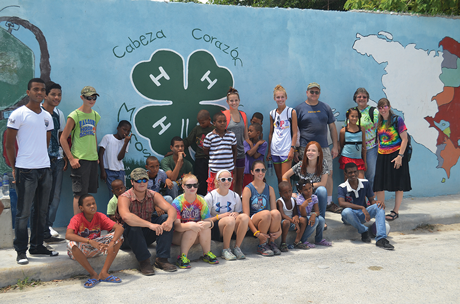 Community members of Domingo Maiz, Dominican Republic, asked the Shenandoah County 4-H group to paint a 4-H clover on the village's mural to recognize the group's community service work with local children.
