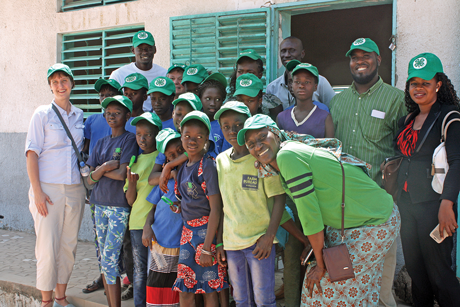 Virginia Cooperative Extension senior 4-H youth development agent Ruth Wallace (left) poses with a group of children and adults in Senegal. In March of this year, Extension and the 4-H Positive Youth Development in Agriculture Program traveled to the West African nation to scale up programming in the region. Reggie Morris, 4-H youth development Extension agent in Alexandria, Virginia, is pictured in the second row, second from right.