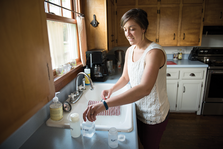 Emily Hutchins of Blacksburg, Virginia, fills water collection bottles.