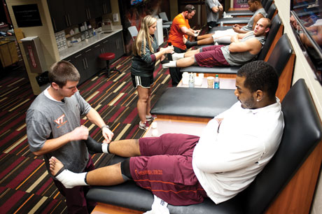 James Kiefer, a human nutrition, foods and exercise major, attends every Virginia Tech football practice and home game as a student athletic trainer.