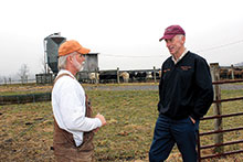 Cattle producer Joey Davenport (left) talks about upcoming educational opportunities with Phil Blevins, agricultural and natural resources Extension agent in Washington County, Virginia.