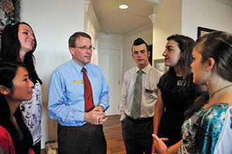 Eric Kaufman speaks with students at a tea held in the Kaufman family's apartment in East Ambler Johnston Hall.
