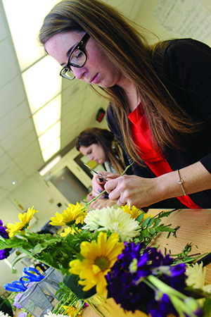 Abby Youmans, a senior majoring in accounting, says the floral design classes are a good creative outlet.