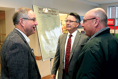 Hampton Roads AREC director Pete Shultz (left) speaks with Virginia Tech President Timothy Sands (center) and Virginia Tech Board of Visitors member Steve Sturgis (right) at the Eastern Shore Ag Conference and Trade Show.
