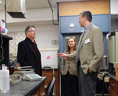 Associate Professor Mark Reiter (right) shows Virginia Tech President Timothy Sands his laboratory at the Eastern Virginia AREC.