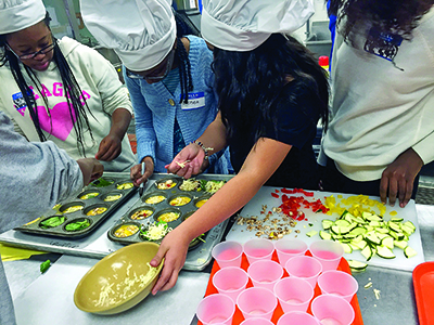 Students in the Teen Cuisine program  learn about nutrition education.