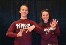 Students hold up their hands to spell out VT.