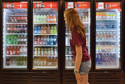 A student looks at beverage choices.