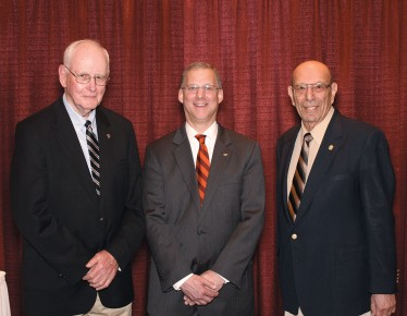 Dean Alan Grant (center) congratulates Richard Saacke (left) and Paul Siegel (right) on their inclusion into the college's Hall of Fame.