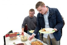 Students in Jacob Barney's class try dishes concocted using invasive species for an end-of-semester potluck.