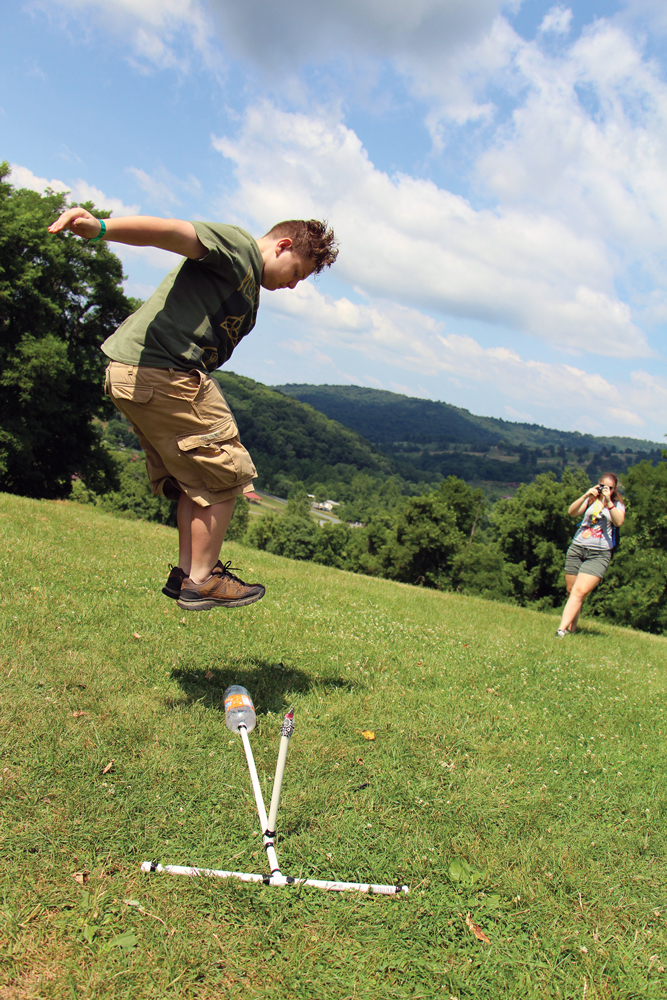 A teenager launches a homemade rocket.