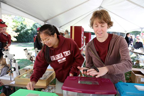 Graduate students show off bugs from the first Hokie Bugfest, held in 2011