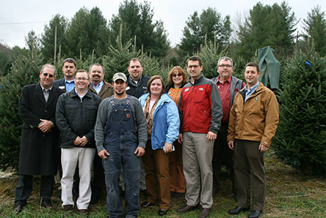 VALOR Fellows visit with Matthew Phipps of Bottomley Evergreens, an operation that harvests and ships Christmas trees in Grayson County, Va.