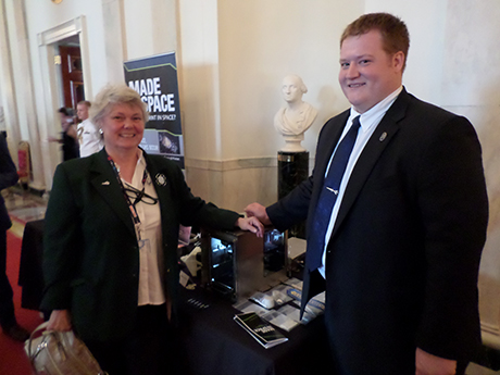 Kathleen Jamison speaks with former 4-H member Michael Snyder about his 3D printer, which will be the first manufacturing devise to be used in space.