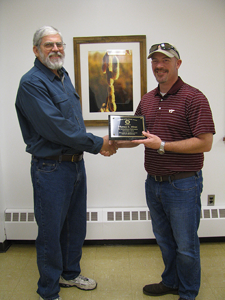 Tommy Hines (on left) receiving award from Steve Rideout
