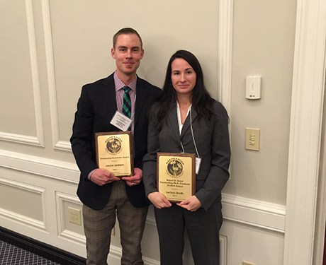 Jacob Barney and Larissa Smith with their awards