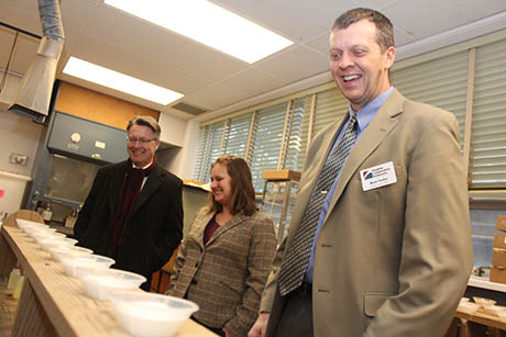 Mark Reiter (right), an associate professor in crop and soil environmental sciences, shows his work to President Sands.