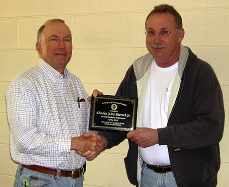 Charles Barrack receiving his Employee of the Month award from Bob Pitman, superintendent of the Eastern Virginia Agricultural Research & Extension Center