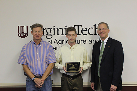 Ryan Mays accepting his award alongside Scott Salom (left) and Dean Alan Grant