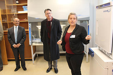 Laura Strawn explains her research to Virginia Tech President Tim Sands (center) and Associated Dean of Research Saied Mostaghimi (left)