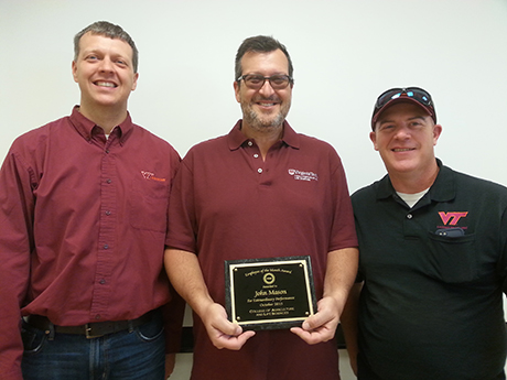 John Mason receiving his award alongside Mark Reiter (left) and Steve Rideout (right).