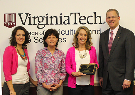 February Employee of the Month Cynthia Beatty receiving her award. From left: Lisa Racek, Susan Sumner, Cynthia Beatty, and Dean Alan Grant