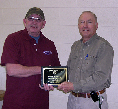 David Dunaway (left) receiving his Employee of the Month plaque from Robert Pitman, director of the Eastern Virginia Agricultural Research and Extension Center